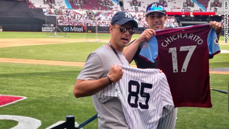West Ham United's Mexican striker Javier Hernandez, known as Chicharito, swaps jerseys with countryman Luis Cessa, a pitcher for the New York Yankees before the meeting between the Yankees and the Boston Red Sox in London on Sunday.