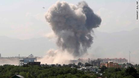 Smokes rises after an explosion in Kabul on Monday