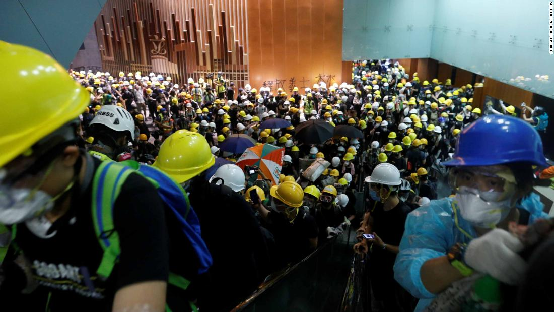 Protesters stream into the Legislative Council building.