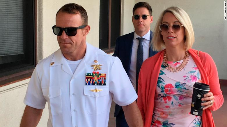 Navy Special Operations Chief Edward Gallagher left walks with his wife Andrea Gallagher as they arrive to military court on Naval Base San Diego Monday