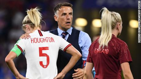 Phil Neville consoles England captain Steph Houghton after the Lionesses' Women's World Cup semifinal defeat.