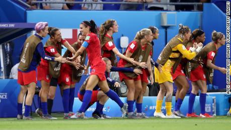 The US team celebrates after Alex Morgan's goal.