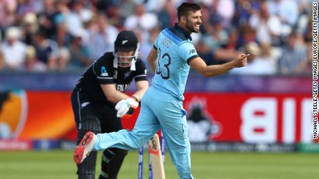 Mark Wood of England celebrates bowling Jimmy Neesham of New Zealand.
