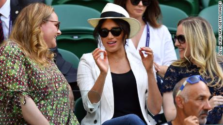 Britain's Meghan, Duchess of Sussex (center) watches Serena Williams at Wimbledon.