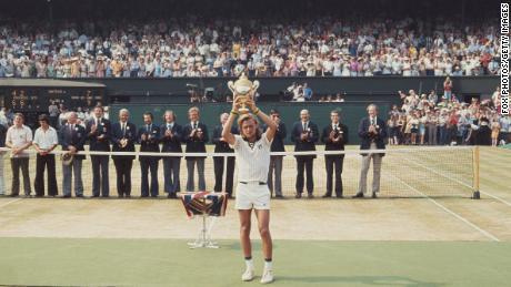 Bjorn Borg holds the trophy aloft after defeating Ilie Nastase to win Wimbledon in 1976.