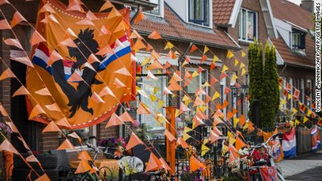 A street is decorated with banners of orange flags in Deventer, Netherlands.