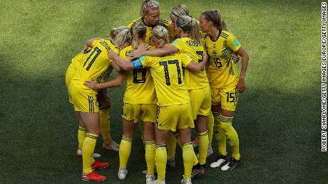 Sofia Jakobsson  celebrates with teammates after scoring Sweden's second goal.