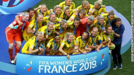 Sweden's players celebrate with their third place medals.
