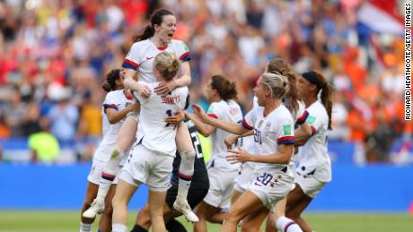 Rose Lavelle of the USWNT celebrates with Emily Sonnett after winning Women's World Cup final.