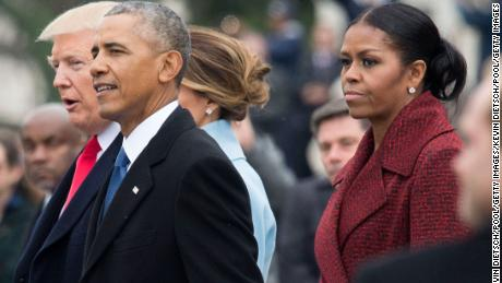 President Donald Trump (L), former President Barack Obama (C) and former First Lady Michelle Obama walk together following the inauguration, on Capitol Hill in Washington, D.C. on January 20, 2017.