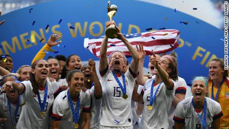 USWNT celebrate with the trophy after winning the 2019 Womens World Cup.