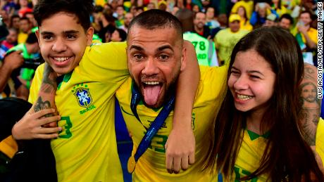 Brazil's Dani Alves (C) celebrates with his daughter Victoria and his son Daniel after winning the Copa America.