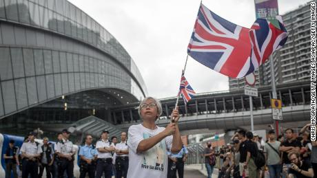 A protester waves a UK flag during a Hong Kong protest on July 7, 2019.