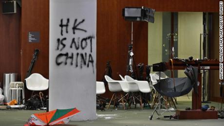 Hong Kong protesters stormed the Legislative Council on July 1, 2019, leaving graffiti and umbrellas.