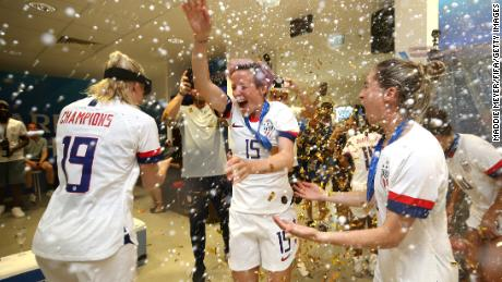 Megan Rapinoe of the USA celebrates in the dressing room following her team's victory in the 2019 FIFA Women's World Cup France Final.