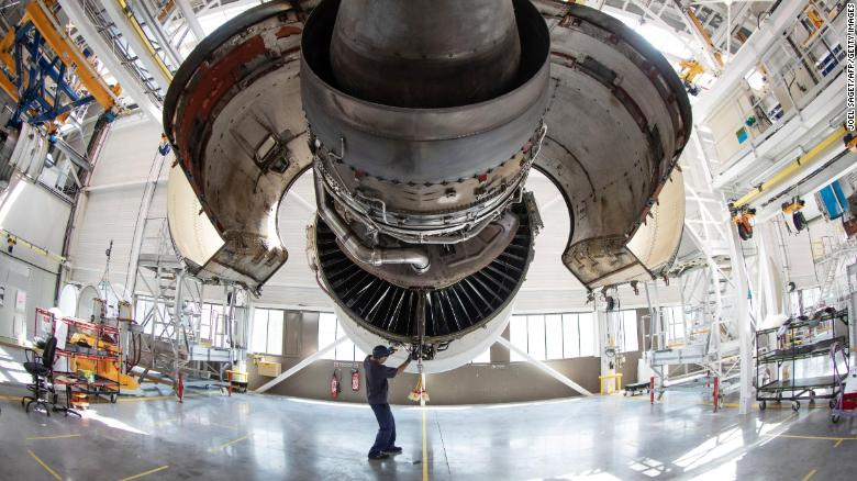 A aircraft maintenance technician works on the engine of an Airbus airplane of the airline company Air France in a maintenance facility at Roissy Charles de Gaulle Airport in Roissy north of Paris