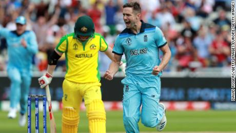 England's Chris Woakes celebrates taking the wicket of David Warner of Australia.