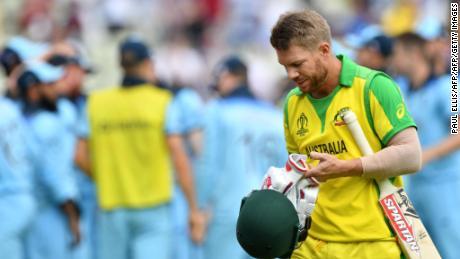Australia's David Warner walks off after being dismissed for nine.