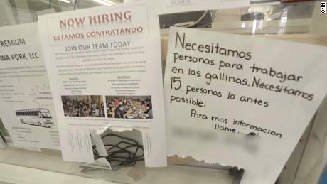Job notices posted in English and Spanish on a Worthington storefront.