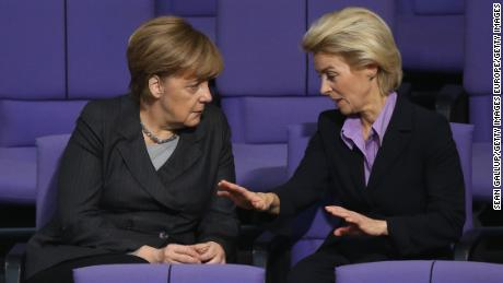 Angela Merkel and von der Leyen, then defense minister, talk ahead of a 2015 vote on military action against ISIS in Syria.