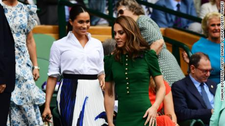 Catherine and Meghan enter the Royal Box for the women's singles final on Saturday.