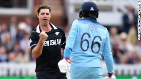 New Zealand's Colin de Grandhomme celebrates taking the wicket of England's Joe Root.
