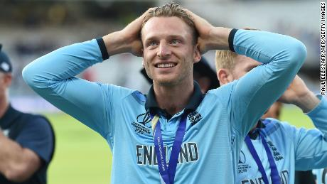 England's Jos Buttler celebrates on the pitch.