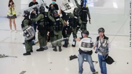 Riot police deploy pepper spray inside the New Town Plaza shopping mall during a protest in the Sha Tin district of Hong Kong on July 14, 2019.