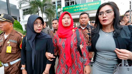 Nuril arrives at the Attorney General's office in Jakarta on July 12.
