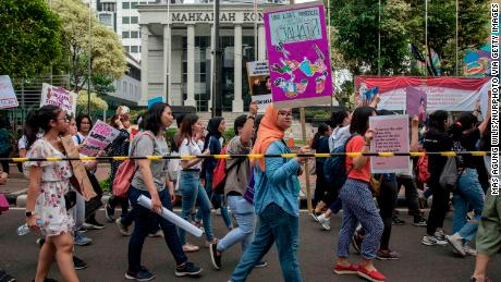 Protesters at the Women's March on Jakarta in April call on the government to approve draft law on the Elimination of Sexual Violence.