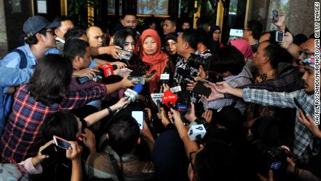 Baiq Nuril Maknun (center) speaks to the press outside the Ministry of Law and Human Rights office on July 8.