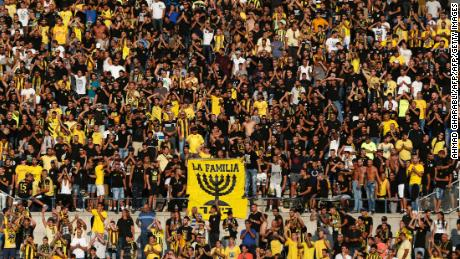Beitar Jerusalem fans cheer on their team.