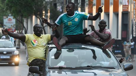 Supporters in Dakar celebrate after Senegal won the AFCON semifinal against Tunisia.
