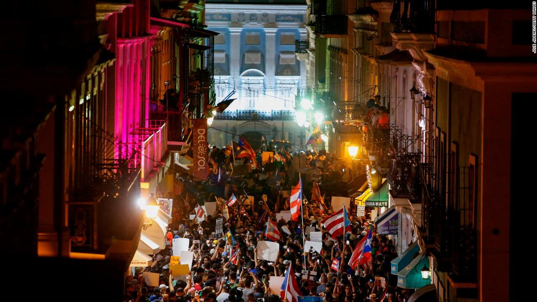 Thousands of demonstrators protest in front of the governor's mansion on Wednesday.