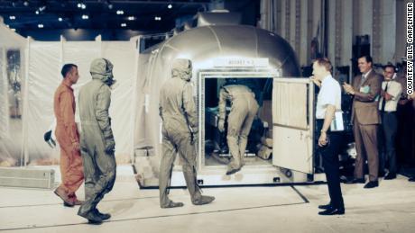 Carpenter, far left, goes in quarantine with the astronaut of Apollo 11.