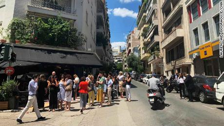 Athens residents flee buildings as strong natural disaster  hits Greek capital