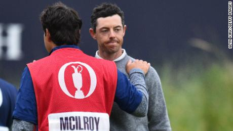 McIlroy is consoled by caddie and best friend Harry Diamond.
