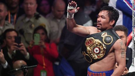 Manny Pacquiao sports another belt in his legendary boxing career.