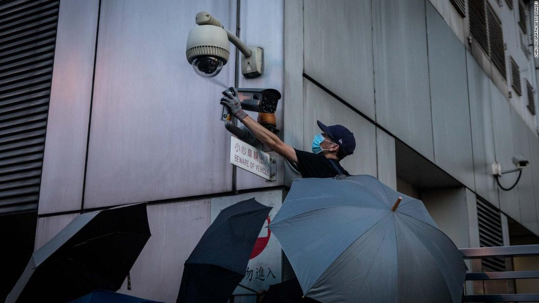 A protester covers a security camera outside the Chinese government's liaison office in Hong Kong.
