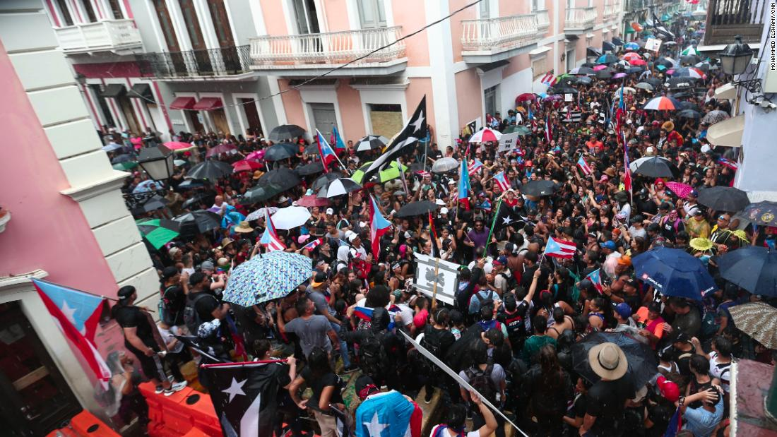 Protesters block the way to Rosselló's residence on Monday.