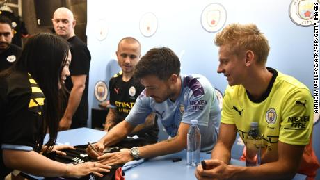 David Silva signs shirts for fans in Hong Kong.