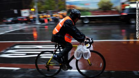 Food delivery companies are facing scrutiny over how workers are paid. (Jewel Samad / AFP / Getty Images)