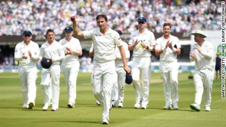 Tim Murtagh salutes the crowd as he leaves the field after taking five wickets .