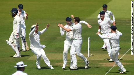 Tim Murtagh celebrates with team mates after dismissing Moeen Ali to give him his fifth wicket.