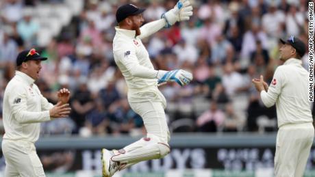 England's Jonny Bairstow (C) celebrates catching the ball to take the wicket of Ireland's William Porterfield.