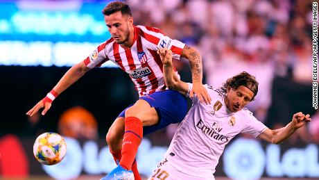 Real Madrid's Croatian midfielder Luka Modric (R) and Atletico Madrid's Spanish midfielder Saul Niguez (L) vie for the bal.