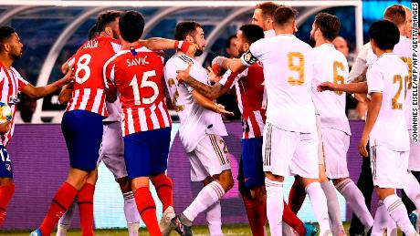 Real Madrid's Dani Carvajal brawls with players from Atletico during the 2019 International Champions Cup clash.