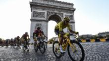 Colombia's Egan Bernal rides down the Champs Elysees alongside the Arc de Triomphe.