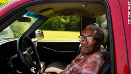 Alander Baldwin, 77, parked in the line for water distribution on the street outside Greater Holy Temple at 5 p.m. He comes consistently every week for almost two years. He sometimes goes to different places for water because