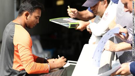 Prithvi Shaw signs autographs during the first Test in the series between Australia and India at Adelaide Oval on December 10, 2018.